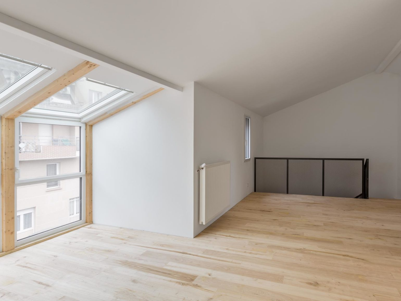 Le2bis-Agence d'architecture toulouse-Surélévation contemporaine minimaliste Maison Toulouse-Espace Atelier-Bow window-Charpente-Parquet chataigner